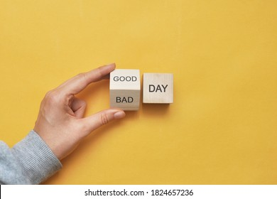 """Inscription: """"bad or good day"""" on wooden blocks. Choosing what day it will be today."""
