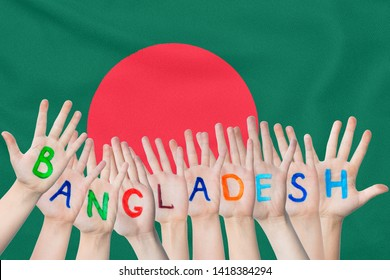 Inscription Bangladesh on the children's hands against the background of a waving flag of the Bangladesh