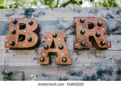Inscription bar Brown closeup on wooden background