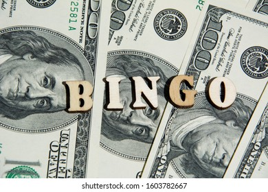 The inscription bingo on the 100 dollar bills background. 100 dollar banknotes. Casino Cash Money Winner.