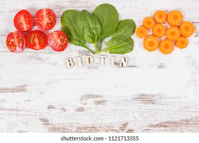 Inscription biotin with healthy products and ingredients as source vitamin B7, dietary fiber and natural minerals, concept of nutritious eating, copy space for text
