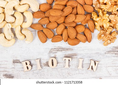 Inscription biotin with various dried fruits containing vitamin B7 and dietary fiber, natural sources of minerals, healthy nutrition concept