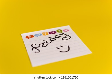 inscription in black marker on Friday on a white sticker yellow background