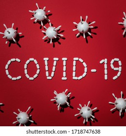Inscription COVID-19 on Red Background. (WHO) World Health Organization Introduced COVID-19, a New Official Name for Coronavirus