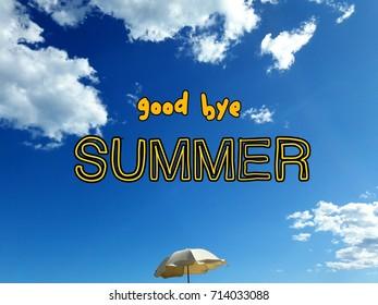 Inscription Good Bye on a sky background with a beach umbrella.