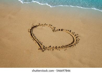 inscription heart on beach sand