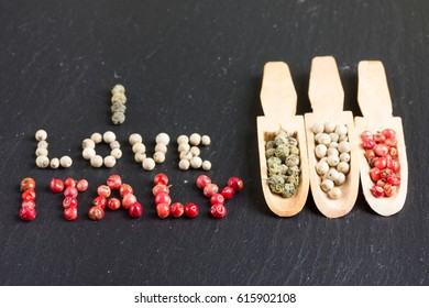 "Inscription ""I love Italy"" with three wooden spoons with other kinds of pepper"