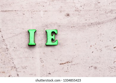 Inscription I.E. ID EST that is abbreviation in wooden letters on a light background.