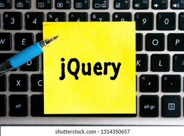 "The inscription ""jQuery"" on a yellow sheet of sticker paper on the background of a computer keyboard."