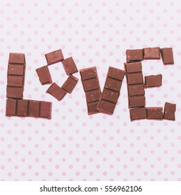 The inscription 'Love' by chocolate. Minimal and creative gift card.