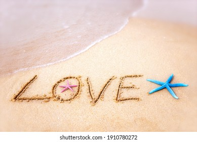 """The inscription """"LOVE"""" on the seashore with starfish. Valen's day"""