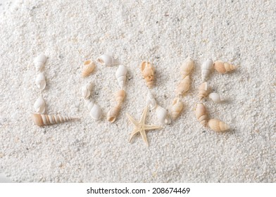 the inscription love in the sand