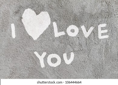 inscription I Love you with abstract heart on the concrete wall