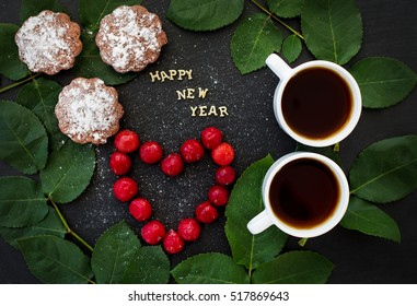 inscription of new year on a black board with cupcake and heart in the form of cherries - Shutterstock ID 517869643