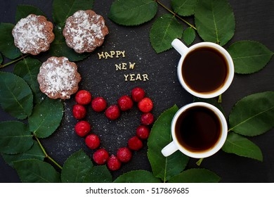 inscription of new year on a black board with cupcake and heart in the form of cherries - Shutterstock ID 517869685