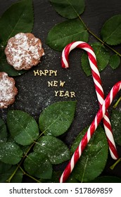 inscription of new year on a black board with cupcakes and candy red - Shutterstock ID 517869859