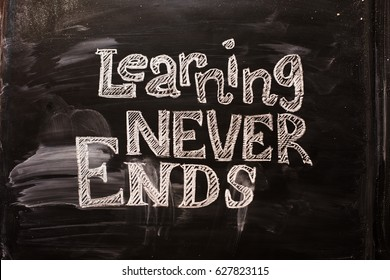 Inscription on a black chalk board: learning never ends