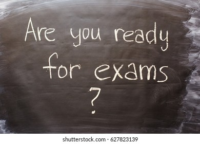 Inscription on a black chalk board: Are you ready for exams?