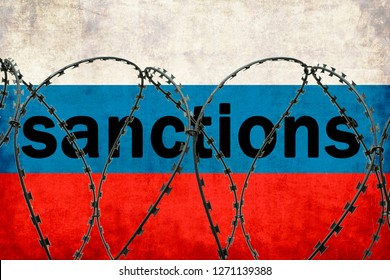 The inscription on the Russian flag Sanctions. Fenced with barbed wire. Signs, symbols