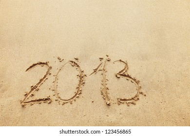 The inscription on the sand - 2013, the new year. Background.