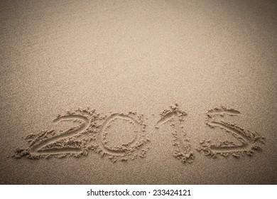 """inscription on the sand - """"2015"""""""