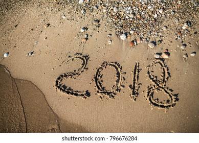 The inscription on the sand 2018