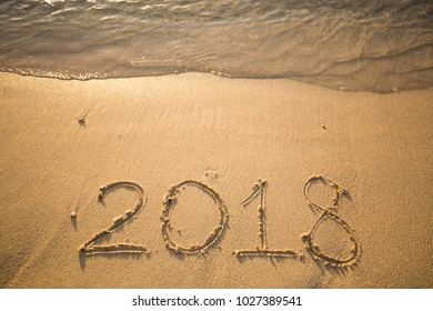 The inscription on the sand in 2018, which washes off a wave.