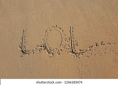 Inscription on sand lol/the word lol in the sand