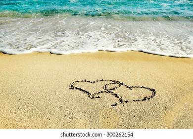 the inscription on the sand seashore