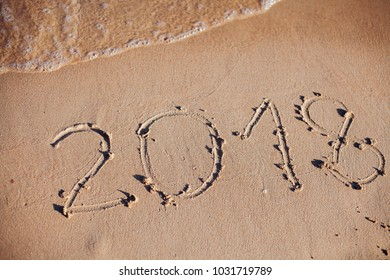 inscription on the sand, the inscription on the shore of the ocean in the summer of year