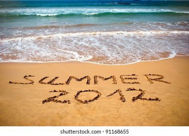 Inscription on wet sand Summer 2012