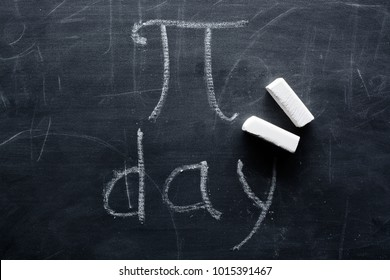 The inscription of PI day and chalk on a blackboard