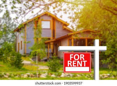 Inscription for rent as a symbol of rental property. Rental property business. Purchase of real estate for further lease. Two small cottages in background. Working in rental property business.