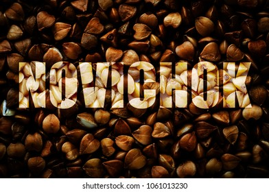 """Inscription with Russian in Latin transcription """"Novichok"""". In Russian this means """"Novice"""". Buckwheat background. News concept"""