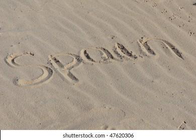 """Inscription """"Spain"""" on a sand."""