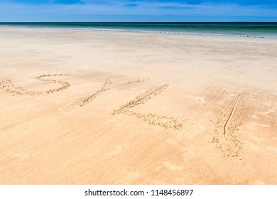 Inscription Sylt on the beach sand. The island of Sylt, Germany.