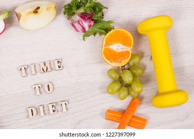 Inscription time to diet with fuits and vegetables and dumbbell for using in fitness, concept of nutritious food and healthy lifestyles