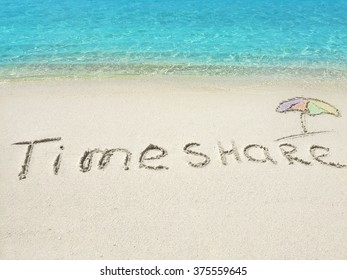 """Inscription """"Timeshare"""" in the sand on a tropical island,  Maldives."""