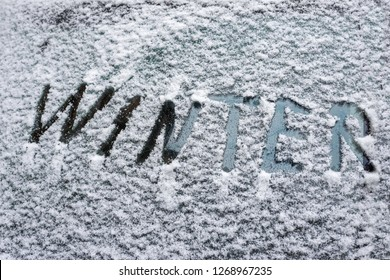 """The inscription """"Winter"""" on a car windshield. Winter has come"""