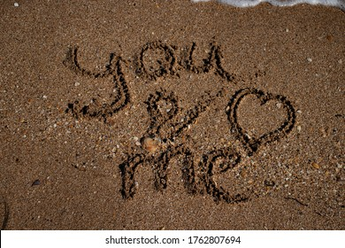 "The inscription ""you and me"" on the sea sand"