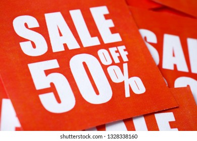 Inscriptions on sale in percentages (50) printed on red paper.