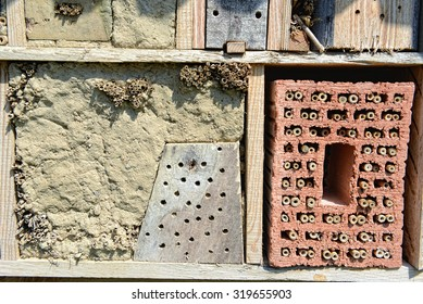 insect hotel with bamboo sticks and brick stone. for wild bees