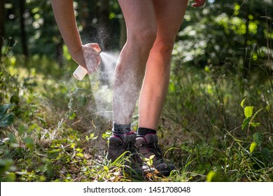 Insect repellent. Woman applying mosquito repellent in forest. Skin protection against tick and other insect.