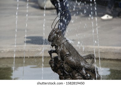 Insect statue in water fountain