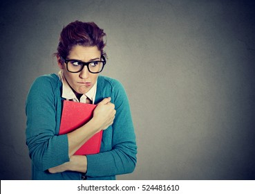 Insecure nerdy young woman student