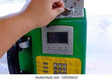 Insert coin Pay Phone side way at Bangkok Thailand