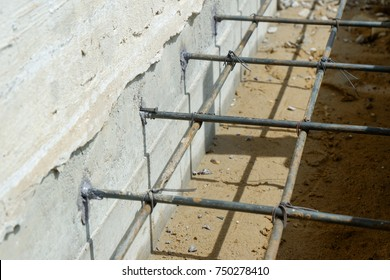 Insert ties steel to concrete wall with epoxy