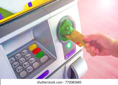 Inserting card to atm machine to withdraw or transfer money finance, bank and people concept