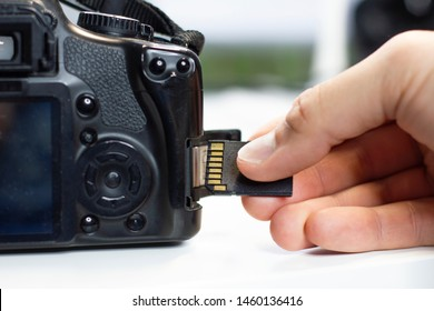 Inserting sd card by hand in a camera, insert flash card
