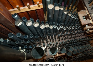 Inside a 19th century organ with zoom on pipes from the top